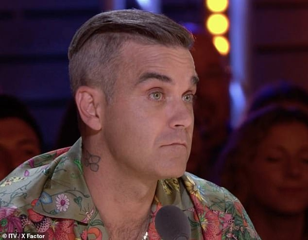 Robbie Williams reveals there was a contract out to KILL him as he details the scary side of fame